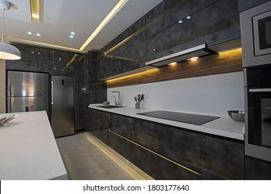 Interior design decor showing modern kitchen with cupboards in luxury apartment showroom
