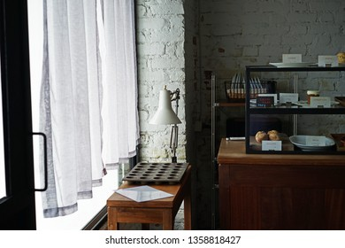 Interior design and decoration of coffee shop and bakery bar -decorated with display case box and wooden furniture
