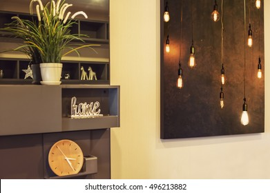 Interior Design Details. Big Picture on the wall in living room, art photo of light bulb