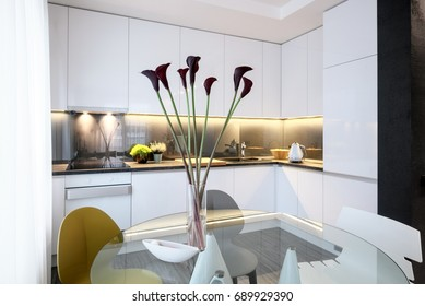 Interior design - dining table with glass top and chairs in a white modern kitchen