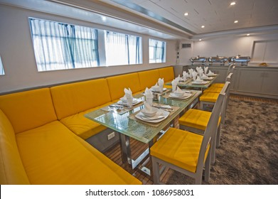 Interior design furnishing decor of the salon dining area in a large luxury motor yacht