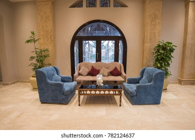 Interior design of a luxury hotel resort lobby reception area with sofa seating
