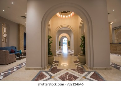 Interior design of a luxury hotel resort lobby reception area with seating and columns