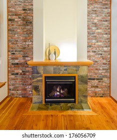 Interior design of a luxury living room with a brick wall and fireplace