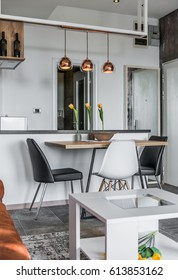 Interior design of modern apartment, dining area and kitchen