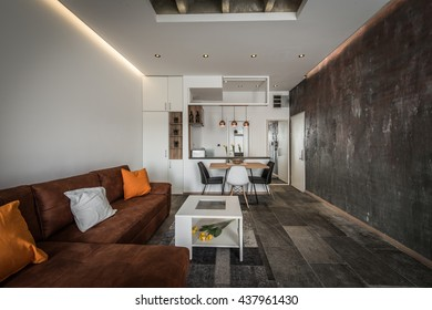 Interior design of modern apartment, living area and open kitchen