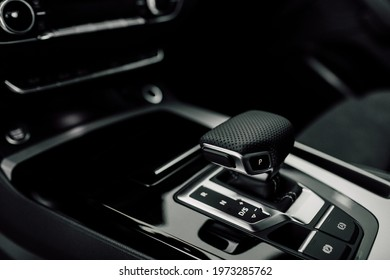 Interior Design of New Car. Automatic gearbox and media controller close up. Details inside car. Detail of luxury car interior.