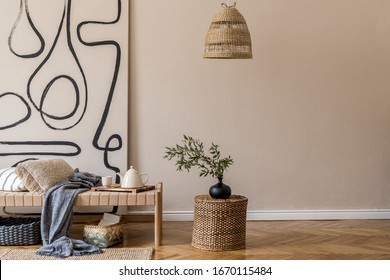 Interior design of oriental style living room with modern chaise longue, pillows, plaid, rattan decoration, elegant personal accessories and modern paintings on the beige wall.  - Shutterstock ID 1670115484