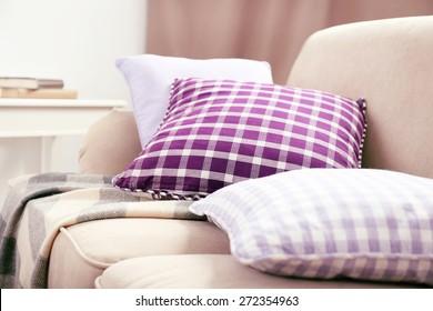 Interior design with pillows on sofa, closeup