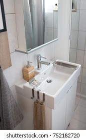 Interior design. Interior shots of a flat. Bathroom scenery with a sink and a water tap.