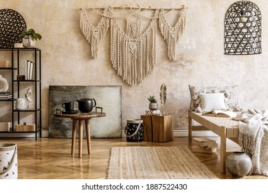 Interior design of stylish living room with chaise longue, beautiful macrame, rattan decoration, plants, book, plant, elegant personal accessories in oriental concept of home decor.