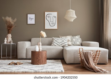 Interior design of stylish living room with modern neutral sofa, mock up poster farmes, dried flowers in vase, coffee tables, decoration and elegant personal accessories in home decor. Template. - Shutterstock ID 1904202550