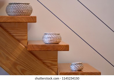 interior design, wooden staircase and colored wicker baskets