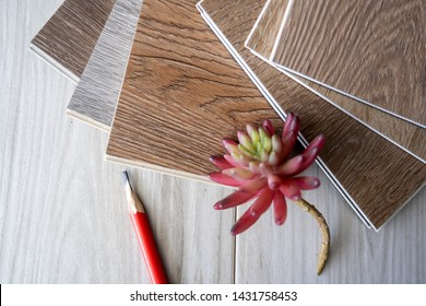 Interior design working on desk by selected click lock type of luxury vinyl wood tiles for home flooring