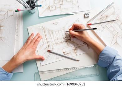 Interior designer drawing pencil illustration of a living room. Interior design projects concept