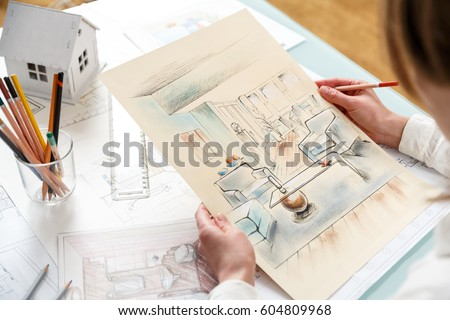 Interior Designer Working On Color Hand Drawings Of Interior At Work Place.  Photo Of Young