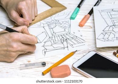 interior designer working on a sketch. background - drawing, markers, pencil, eraser, ruler, calculator