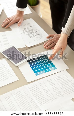 Amazing Interior Designers Or Design Professionals Working With Color Swatches  Palette And House Layout At Office Desk