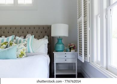 Interior destails of a master bedroom bedside table
