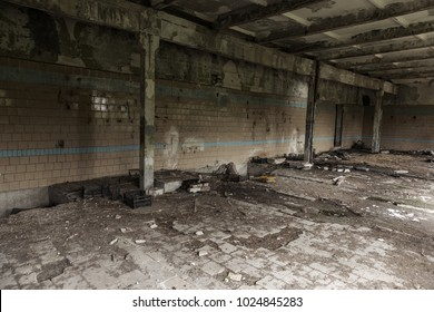Interior of the destroyed buildings of old factory. ruins of an industrial enterprise, dark fragments destroyed factory premises at plant as result of economic crisis Catacombs, basement, tunnel