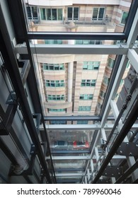 interior details - looking through glass elevator to buildings, architecture perspective
