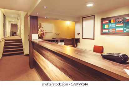 Interior and details of a small hotel reception.
