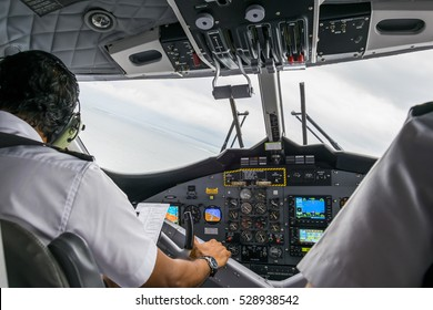 Interior details of a water plane with pilot and co pilot on board while flying. The photography is a demonstration of team work.