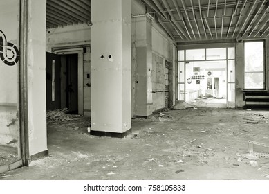 The interior of a devastated building. Black and white.