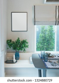 Interior of dining room with blank picture frame on grey wall and plant pot in corner.