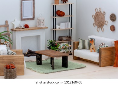 Interior of a doll house living room with sofa, armchair, coffee table, book shelves and fireplace, Wooden ecofriendly toys, Light Scandinavian style room