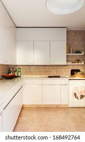 Interior, domestic kitchen, white cabinet