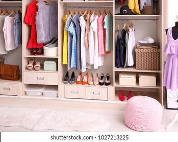 Interior of dressing room with big wardrobe