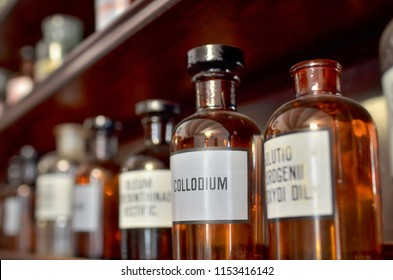 Interior of drugstore museum. Glass bottles have white labels with Latin inscriptions on them.