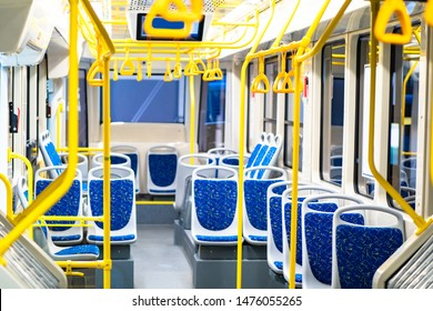The interior of the electric bus is empty. For the passengers seat, handrails and overhead pens in transport. Electrobus. Passenger transportation. Public transport.