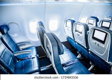 Interior of an empty airplane. View from the back of the plane. Nobody on the plane. Abstract air travel photo.