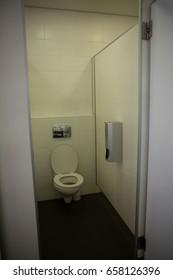 Interior of empty bathroom seen through open door at school