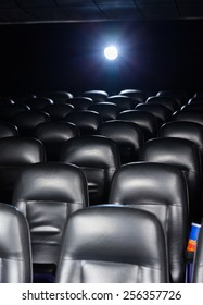 Interior of empty cinema theater with projector light
