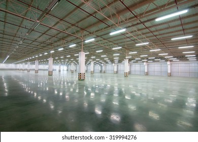 Interior of empty hall a lot of fluorescent light factory