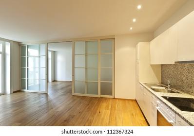 interior empty house with wooden floor, kitchen