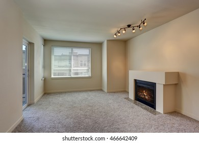 Interior of empty living room with fireplace and carpet floor. Northwest, USA