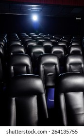 Interior of empty movie theater with projector light
