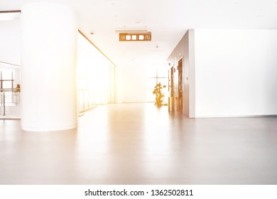 interior empty office room with white wallpaper without furniture in a new building. Big space with city view from the window. Background concept.