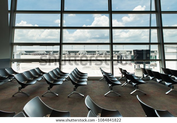 Interior empty seats of departure lounge at the airport,Waiting area with chairs