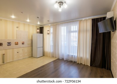 Interior of an empty studio apartment without furniture