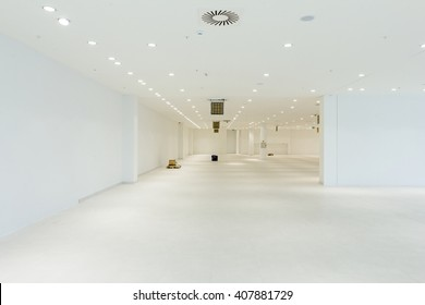 "Interior of empty unfinished modern mega market. Architecture concept. Empty white room has white walls. Shopping center ""AVIV PARK"" in Zrenjanin, Vojvodina, Serbia, 11.09.2015."
