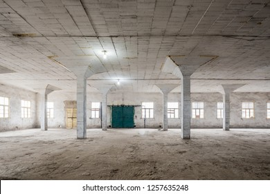 Interior of empty warehouse , large spacious room, illuminated by natural light from windows,Empty interior space,  Industrial interior of an old factory