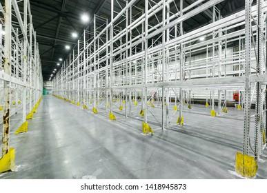 Interior of empty warehouse with empty racks
