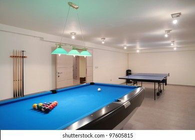 Interior of an entertainment room, billiard and tennis table details.