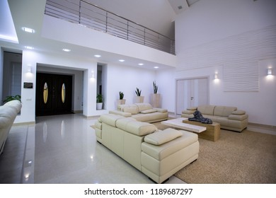 interior of the entrance hall of a  house with leather sofas
