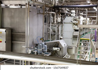 Interior and equipment of modern beer bottling lines at brewery